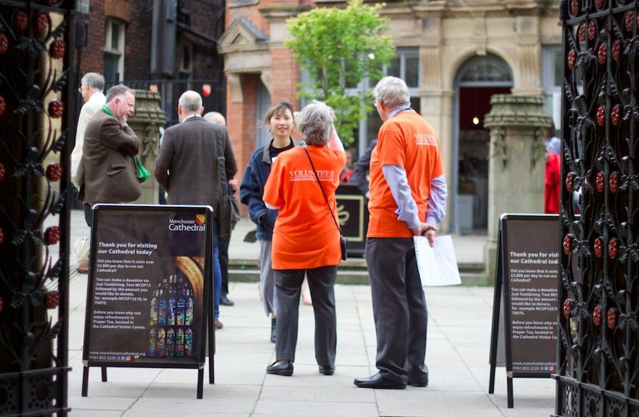 Volunteers outside the Cathedral