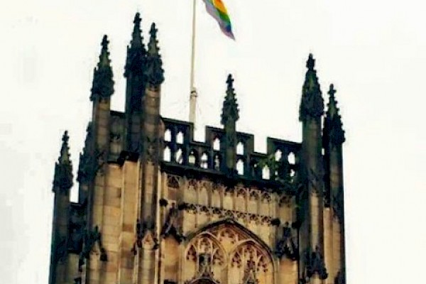 Pride flag flying above Manchester Cathedral